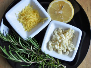 Clockwise from top: Lemon zest, lemon, garlic, rosemary.