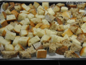 Drying out the bread cubes in the oven.