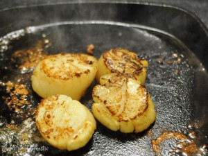 Sear the scallops for 1 minute per side