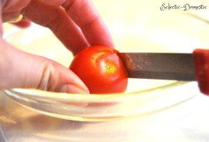 Cut a hole in the cherry tomato about the size of your mozzarella ball.